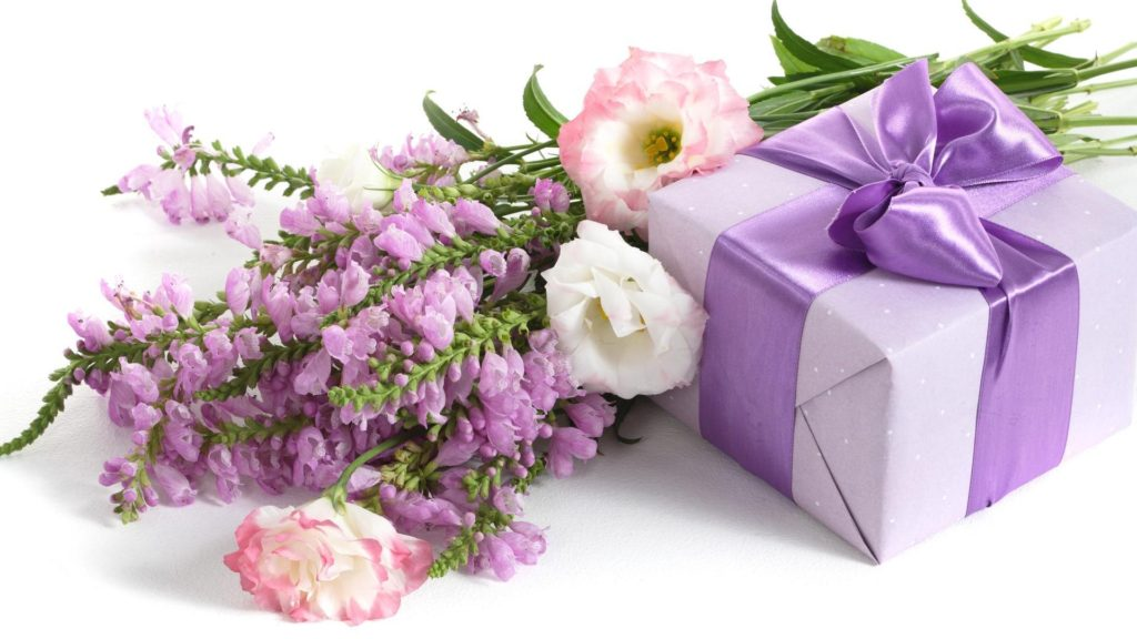 Holidays___International_Womens_Day_Bouquet_of_flowers_and_a_gift_for_a_girl_on_March_8_057125_